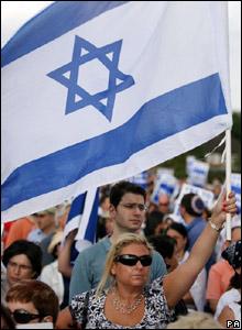 A woman holds the Israeli flag