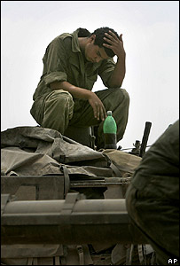 Israeli soldier rests on tank after mission inside Lebanon on 23 July