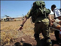 Israeli troops evacuate a UN observer wounded in fighting inside Lebanon