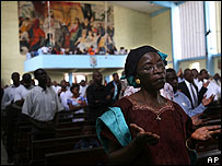 Roman Catholics at prayer in Kinshasa on 23 July