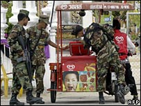 Thai troops check a food cart in Narathiwat, 16 June 2006