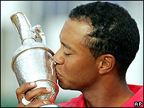 Tiger Woods embraces the famous Claret Jug after his emotional Open victory Hoylake