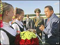 Venezuelan President Hugo Chavez is welcomed upon arriving in Belarus