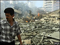 A  man walks amidst rubble in southern Beirut