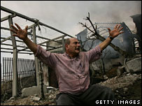 Man cries after the bombing of a telecoms complex north of Beirut