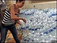 Volunteer prepares bottled water supply for homeless in Lyon