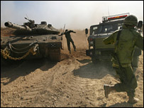Israeli troops ferrying wounded