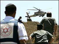 Israeli helicopter and ground troops rush to help wounded