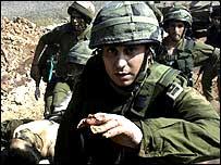 Israeli soldiers evacuate an injured colleague