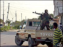 Islamist militia patrol with a vehicle in Mogadishu
