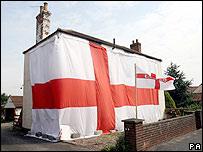 A house draped in an England flag