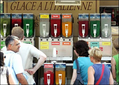 People queue for cold drinks and ice cream in Paris