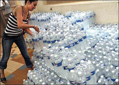 A volunteer in Lyon, south-eastern France, prepares some 3,000 litres of water for homeless people