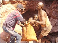 Miners with sack of minerals