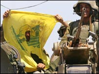 Israeli soldiers with a captured Hezbollah flag