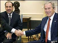 Iraqi PM Nouri Maliki and US President George W Bush