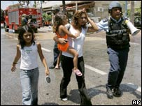 Israelis seek shelter after a rocket attack on Haifa