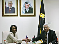 Condoleezza Rice shakes hands with Mahmoud Abbas in Ramallah