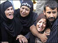 Lebanese family crying at funeral