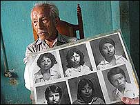 Jorge Hernandez with photos of his daughter