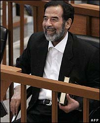 Saddam Hussein laughs in court