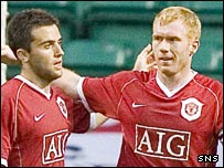 Giuseppe Rossi and Paul Scholes celebrate at Celtic Park