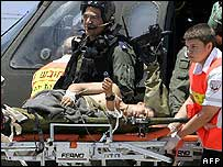 Wounded solider being removed from helicopter