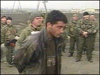 Russian soldiers with Chechen captives