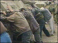 Russian troops with Chechen captives (video grab)