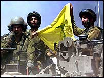 Israeli soldiers with a Hezbollah flag