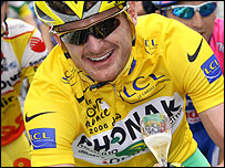 Floyd Landis celebrates his victory on the final stage