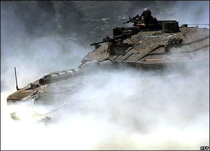 An Israeli tank pushes across the border into southern Lebanon