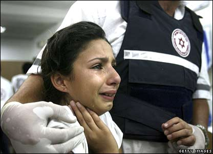 An Israeli girl is treated for shock in an emergency room after a Hezbollah missile strike