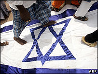 Indian Muslims walk on the Israeli flag during a protest against Israeli actions in Lebanon