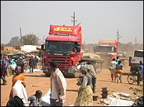 Empty lorries pass through a market in Lubumbashi on their way to the mines, before returning fully laden with minerals