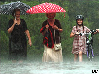 Two women and a girl in the rain