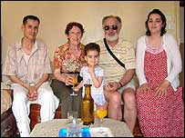 Anne-Marie and husband (middle) in her old flat, Algeria