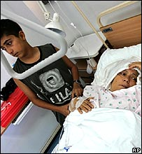 Boy at bedside of mother hurt in Israeli raid, Beirut