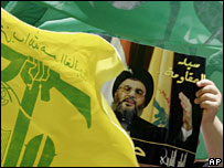 Hezbollah flags and a picture of Sheikh Hassan Nasrallah