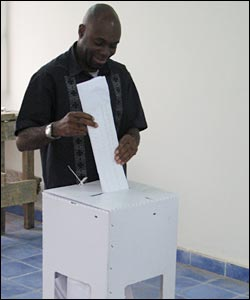 A man posts his ballot.