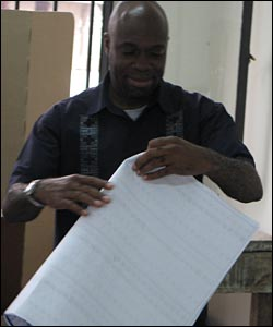 A man folds his ballot paper