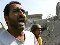 A man screams for help after an Israeli air raid on the southern Lebanese town of Qana