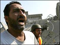 A man screams for help after an Israeli air raid on the southern Lebanese town of Qana