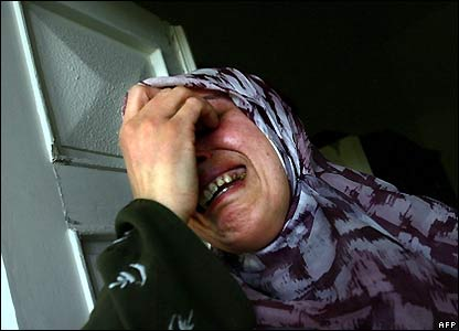 A woman mourns in Qana