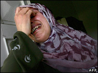 A Lebanese woman mourns after Israeli air strikes on Qana