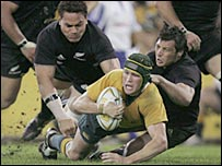 Australia's Matt Giteau is tackled in the defeat to the All Blacks