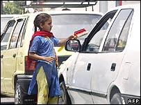 Young girl cleaning a car window in Rawalpindi