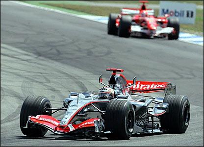 Kimi Raikkonen (foreground) leads from Michael Schumacher