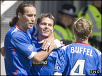 Dado Prso (left) and Libor Sionko (centre) celebrate the opening goal