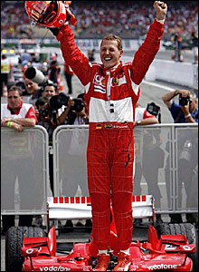 Michael Schumacher celebrates victory in Germany